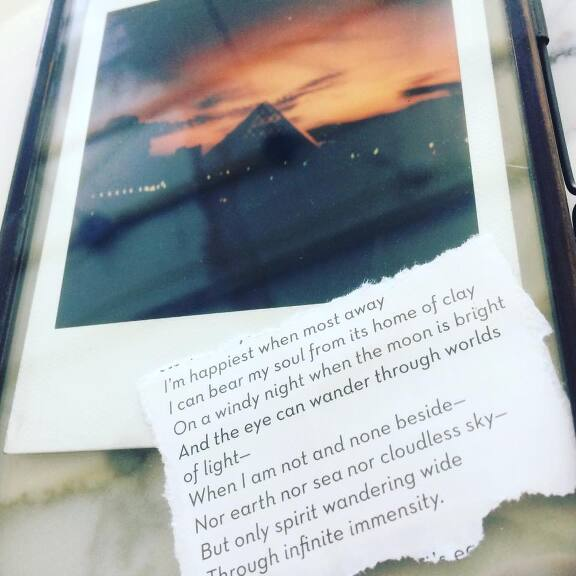 Image of sunset at the Louvre 2017 . Words by Emily Bronte